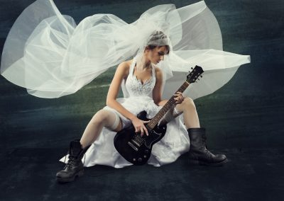 Bride playing rock guitar, wedding funny music